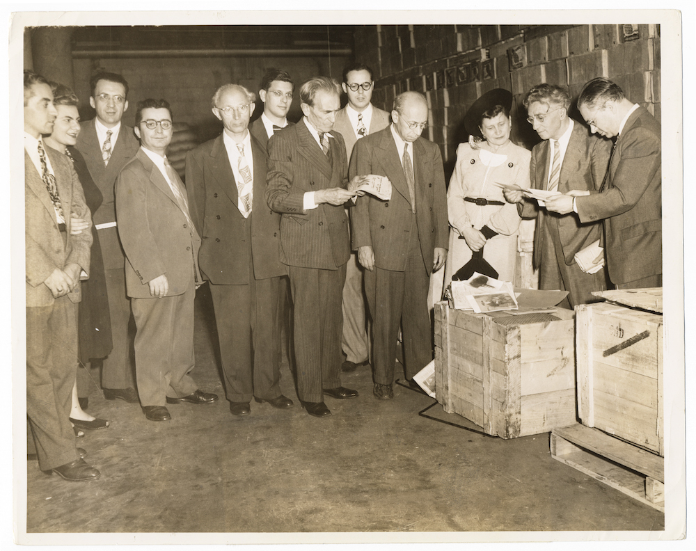 1947.01 - New York - Opening the first crates of rescued materials at the Manischewitz company warehouse - Elkin, Niger, Weinreich.jpg