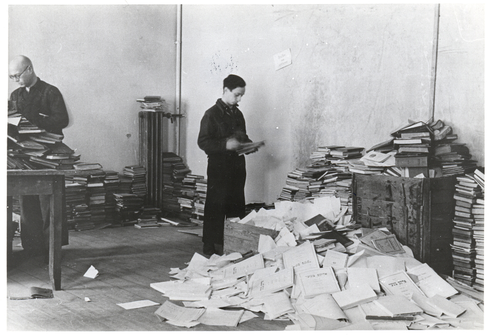 1942.02 - Vilna c 1943 - Workers sorting through books in the YIVO building.jpg